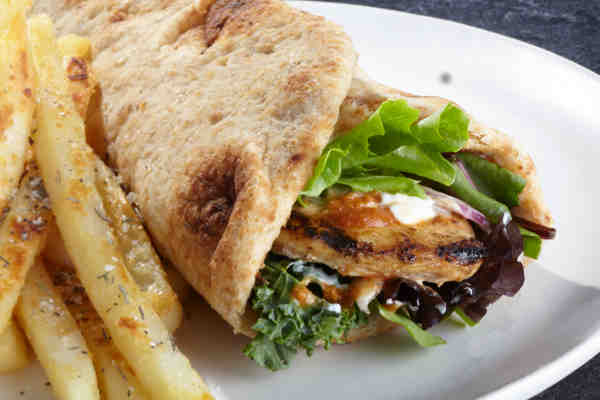 This is another limited time offer at UFood: the chicken curry flatbread. This combines fresh all natural grilled chicken, spicy curry sauce, seasoned  yogurt sauce, and greens in a light and fluffy whole wheat naan flatbread wrap.