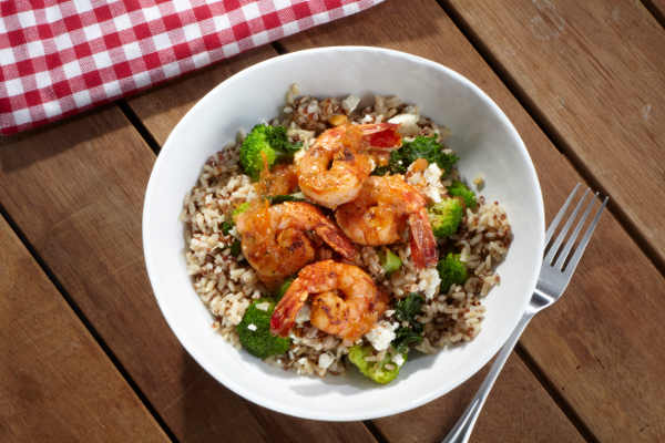 Next is our newest offering on the menu: the Passionfruit Citrus Shrimp Bowl. Juicy grilled shrimp, passionfruit citrus pico, steamed grains, and greens.